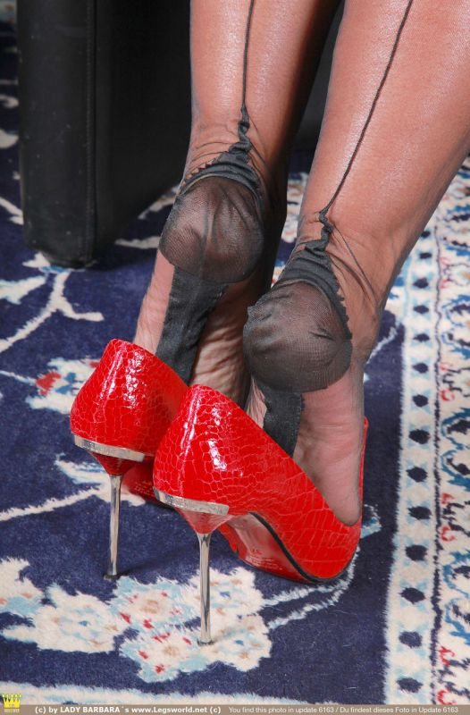 Black nylon soles in red pumps